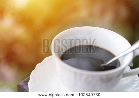 Morning coffee at balcony with sun rise and sun ray soft focus selective coffee