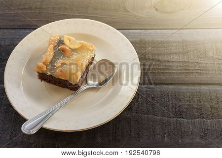 Cashews nut toffee cake on wood table