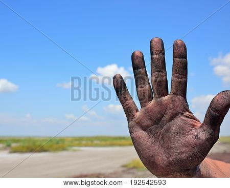 right man's hand on a background of a landscape close up