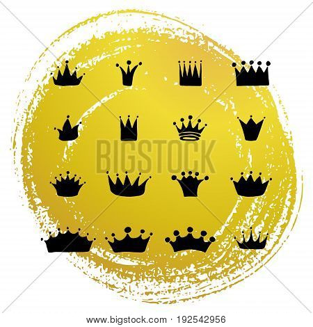 Set of vector hand drawn crowns with golden paint texture.