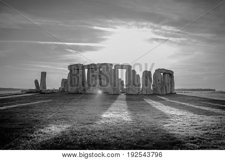 Stonehenge in the light of the setting sun black and white