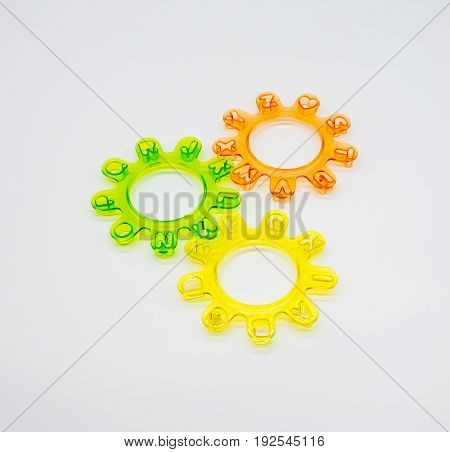 Alphabet cutters setup as mechanical wheels on white isolated background