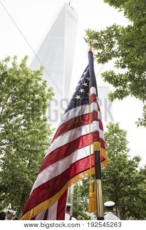 American Flag held in front of the Freedom Tower during the re-enlistment and promotion ceremony at the National September 11 Memorial site. Fleet Week, NEW YORK MAY 26 2017