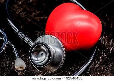 Red heart and a stethoscope health and doctor
