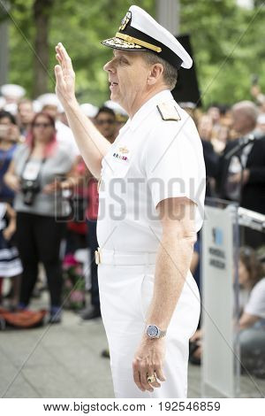 Admiral Phil Davidson, Commander US Fleet Forces Command, swears in military personnel at the re-enlistment and promotion ceremony on the National Sept 11 Memorial site Fleet Week NEW YORK MAY 26 2017
