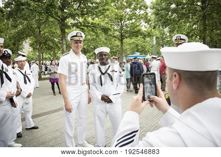 ADM Phil Davidson, CDR US Fleet Forces Command, poses for photographs with sailors at the re-enlistment and promotion ceremony on the National Sept 11 Memorial site. Fleet Week, NEW YORK MAY 26 2017