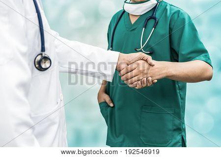 Doctors Shaking Hands. Medical People Teamwork.