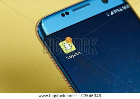 New york, USA - June 23, 2017: Snapchat new message icon on smartphone screen close-up. Snapchat app icon with copy space on screen
