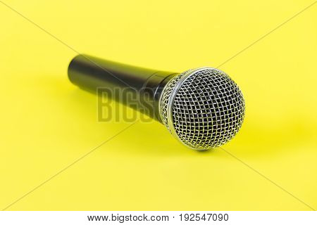 Dynamic Microphone On Yellow Background. Mic