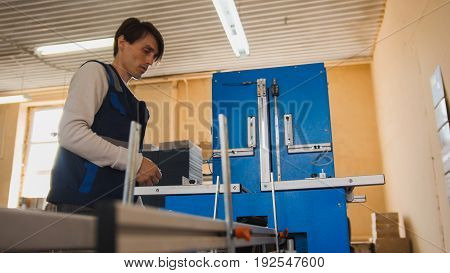 Print operator at work, in a printing factory