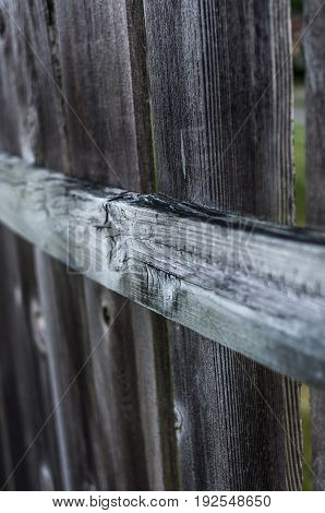 old wooden picket fence with selective focus