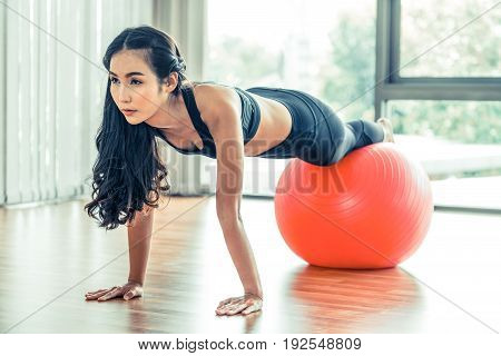 Woman Doing Exercises With Fit Ball In Fitness Gym