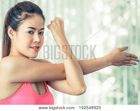 Sporty Woman Doing Arm Stretching