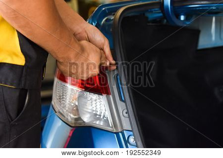 Remove the Taillight of the car,  hand