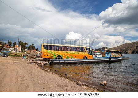 Tiquina, Bolivia - October 22, 2015: Ferries getting loaded with busses and cars for Lake Titicaca crossing