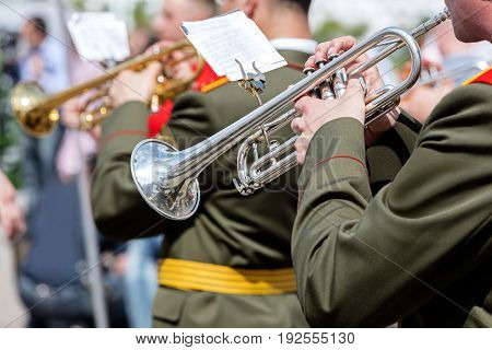 Musician Of Military Orchestra Playing Trumpet During Parade
