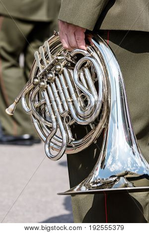 Member Of A Military Orchestra Holding Horn In His Hand During Official Event