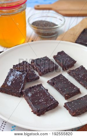 Homemade cacao chia slices with nuts, coconut oil and honey.
