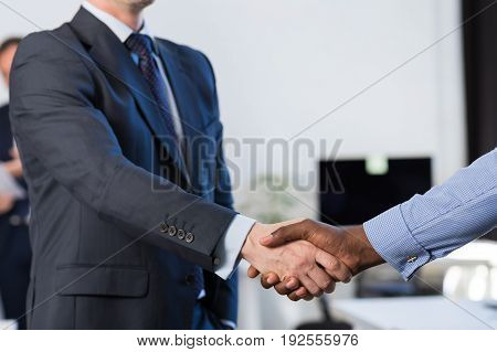 Two Mix Race Unrecognizable Business Man Shake Hand Agreement Coworking Center Business Team Coworkers In Modern Office