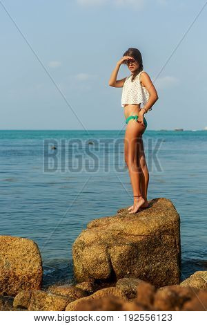 Sensual Girl On Big Stone Near Water.