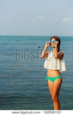 Sensual Girl On Big Stone Near Water.