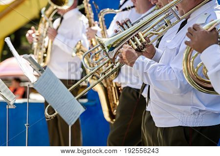 Army Musicians Of Military Orchestra Playing Brass Instruments