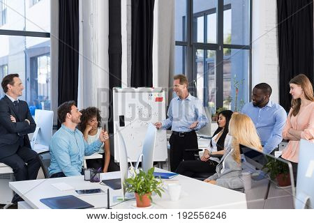 Business Presentation, Businessman Leading Meeting To Businesspeople Group In Boardroom, Team Brainstorming, Discussing New Project, Boss Presenting His Ideas To Colleagues