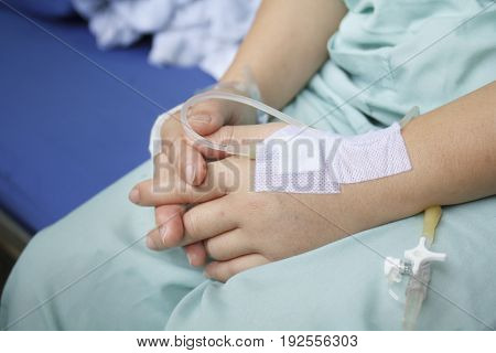 Swollen woman hand  by saline intravenous (iv).
