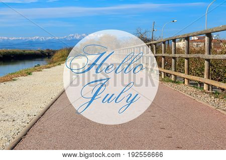 Hello July greeting card with summer trail path and mountains in background