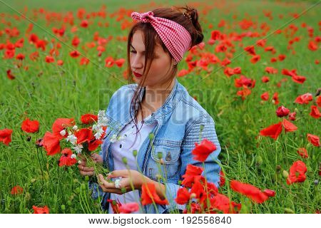 Girl in a poppy field with wildflowers