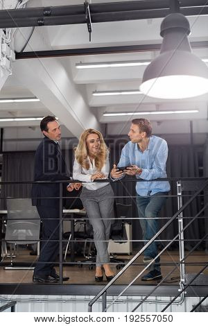 Businesspeople Team Sharing Ideas Stand On Staircase Modern Creative Office Interior Brainstorming Concept, Business Men And Woman Meeting Discussing New Startup Project