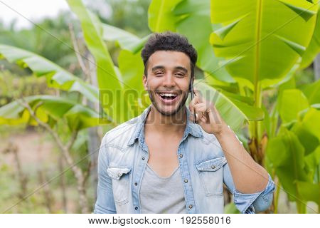 Young Hispanic Man Talking Phone Call Tropical Forest Hotel Terrace Holiday Guy Summer Vacation Travel