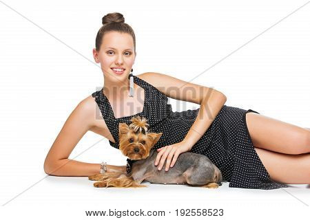 Beautiful young teenage girl in dress holding small cute yorkshire terrier dog. Copy space. Isolated on white background.