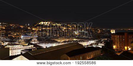 Panoramic view of night Lisbon with Moorish Saint George Castle (Sao Jorge Castle) Portugal