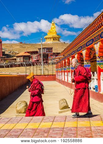 Sichuan China - April 10 2017 : Buddhist monks walking in Yarchen Gar Monastery in Sichuan China