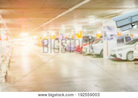 cctv security camera in car parking concept for guards a building, campus, park