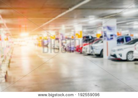 blurred of many cars in parking garage interior public building for background