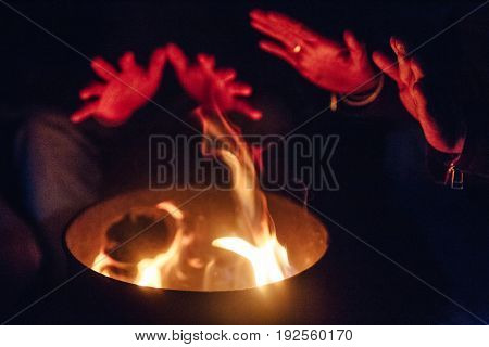 Fire camp with hands. feel so good in freezing cold weather in the night at Lachen in North Sikkim, India.