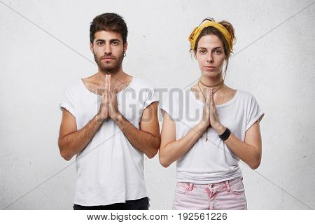 People, Relaxation And Faith Concept. Faithful Man And Woman Keeping Their Palms Together Praying Fo