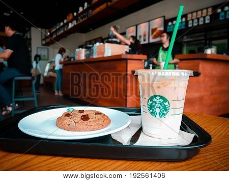 KHON KAEN , THAILAND, 17 JUNE 2017 : A Cup of Starbucks hot beverage coffee on the table in the Starbucks drive thru shop. Starbucks is the world's largest coffeehouse company