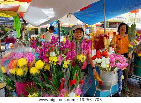 Singapore, Singapore - February 15, 2017: People work in the floral Chinatown at the market on sunny day in Singapore.