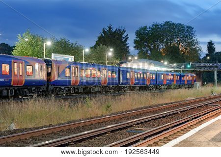 Hook, UK. 24th June 2017. A South West Trains class 450 Desiro EMU train is at Hook station awaiting departure to Basingstoke.