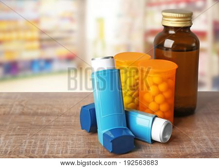 Concept of health care and asthma. Medicines and inhaler on counter at pharmacy