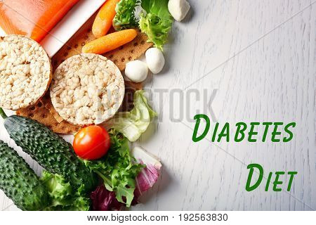 Text DIABETES DIET and healthy food on wooden background. Health care concept