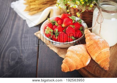 Breakfast from fresh farm products and homemade croissant on a table.