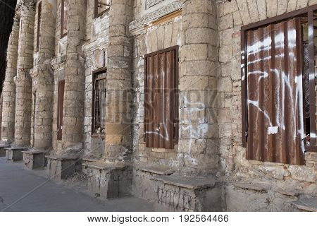 Ancient facade of abandoned building. Photo can be used as a whole background.