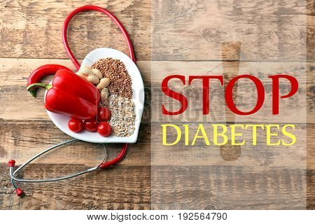 Text STOP DIABETES and healthy food on wooden background. Health care concept