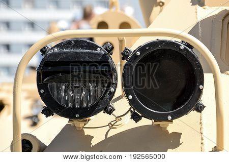Headlamp on a combat vehicle close up