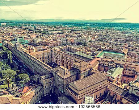 ROME ITALY - JUNE 1 2017: Old photo with aerial view from the cupola of Vatican Papal Basilica over one part of the City.