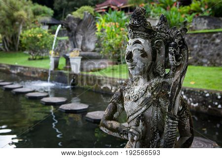 Stone sculpture on entrance door of the Temple in Bali Tirta Gangga, Indonesia